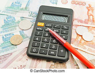 Russian banknotes, coins, pen and calculator