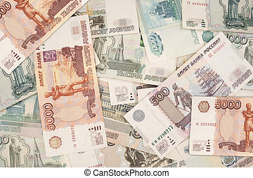 Russian banknotes in denominations of 1000, 500, 100 and 5000 rubles close-up