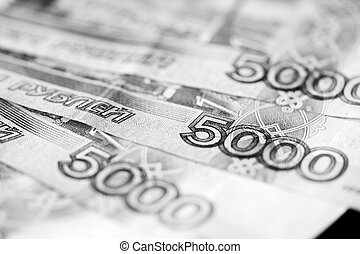 Russian banknotes of five thousand rubles close-up. Monochrome money background