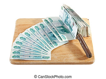 Russian banknotes on a chopping board. Cutting.
