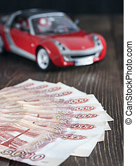 Russian banknotes with toy car