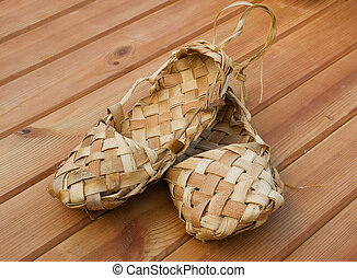 Russian bast shoes standing on the wooden floor