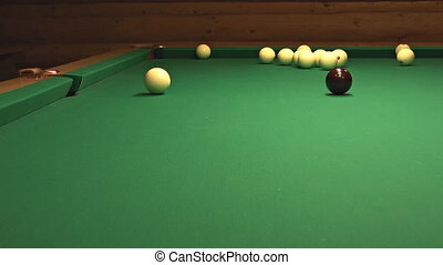 Billiard ball falls into the central pocket.