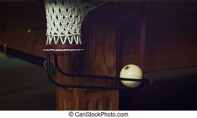Russian billiard white ball falling into corner pocket. Get...