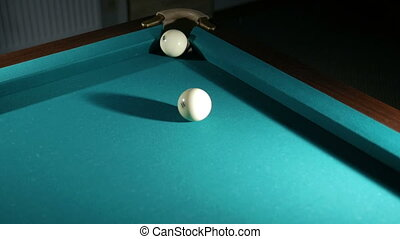 Russian billiards blow cue - successfully. Ball enters the pocket. Close-up.