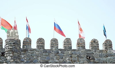 Russian Canadian French Belorussian Georgian Estonian Flags on fortress wall