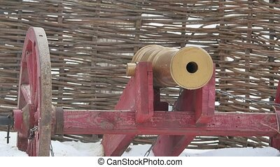 Russian cannon on wooden wheels against the background of a...