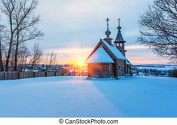 Russian church in winter forest