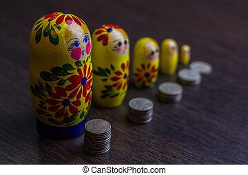Russian coins and russian nesting doll matryoshka