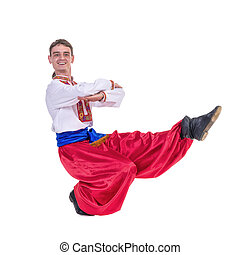 Russian cossack dance. Young dancer in ethnic clothes dancing, full length portrait isolated over white background