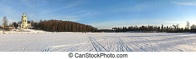 Russian country side. Frozen lake and church.