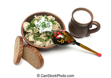 Russian cuisine: dumplings, cup of milk and bread isolated on wh