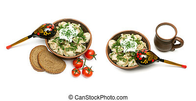 Russian cuisine: dumplings with meat in an earthenware bowl on a white background.