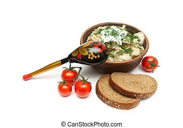 Russian dumplings, cherry tomatoes and bread.