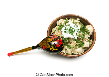 Russian dumplings with sour cream and dill.
