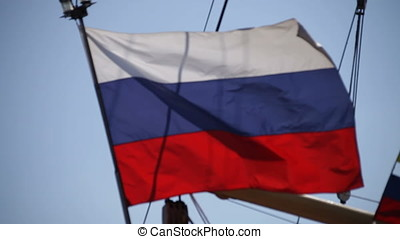 Russian Ensign Flag - Russian ensign flag against clear blue...