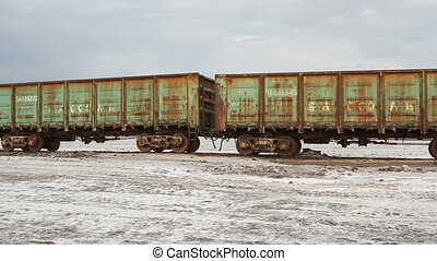 Old rusty train on the salt lake Baskunchak - Russian...