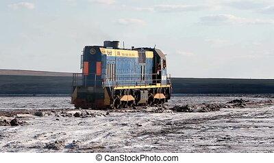 train on the salt lake Baskunchak - Russian Federation,...