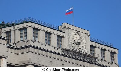 Russian flag above Russian legislative body State Duma....
