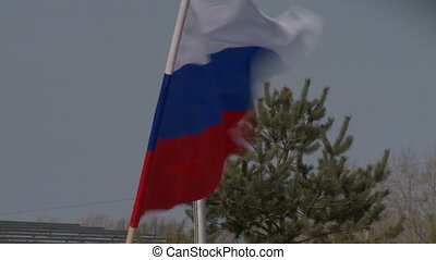 Russian flag fluttering in wind, close-up