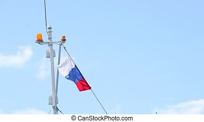 Russian flag fluttering on the top of watercrast