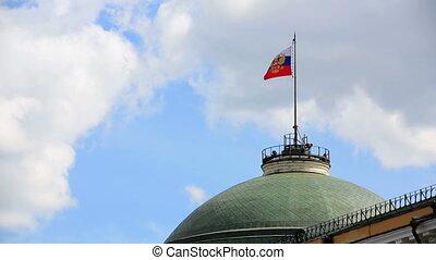 Russian flag flying over Kremlin dome