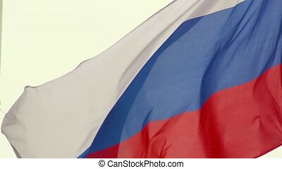 Russian flag, growing in the wind in slow motion