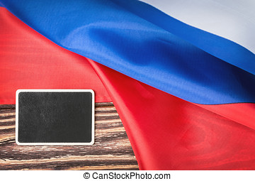 Russian flag on a wooden table