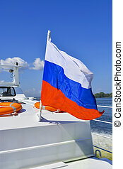 Russian flag on the deck of the boat