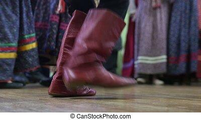 Russian folk dance - foot in boots of boy dancing. close up