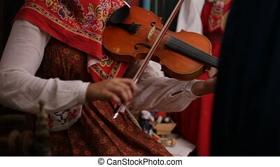 Russian folk group musician - woman play violin, slow-motion...