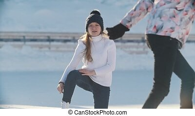 Russian girl skater skating, falling and standing up on a...