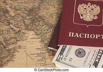Russian International passports with dollars on world map