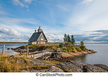 Russian landscape: a small church on the shore of the White Sea. Russian north, Karelia.