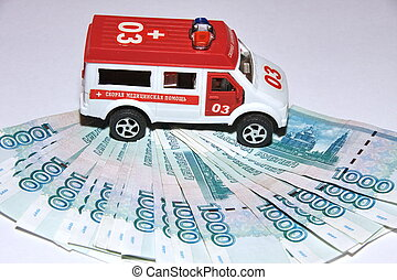 Russian money and a toy ambulance
