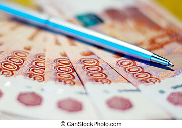 Russian money and pen