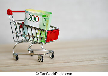 Russian money banknotes in a shopping trolley, online shopping concept.