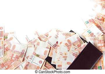 Russian money falls out of the purse. A pile of banknotes of five thousand rubles.