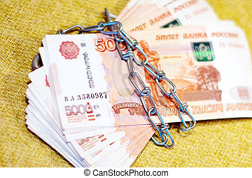 Russian money wrapped in a chain