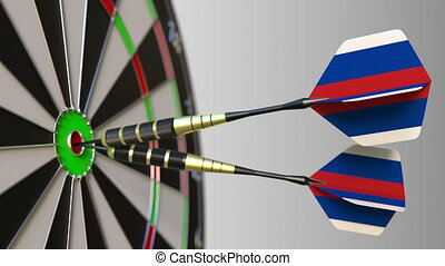 Russian national achievement. Flags of Russia on darts hitting bullseye. Conceptual 3D animation