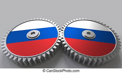 Russian national project. Flags of Russia on moving cogwheels. Conceptual animation