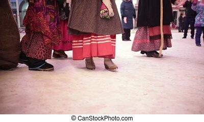 Russian national tradition - kolyadki. People walking on the...