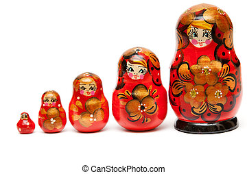 Russian nesting dolls stand in a row on a white background