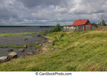 A wooden house on the shore of Lake Onega in Karelia, Russia