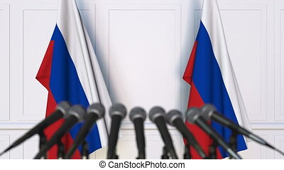 Russian official press conference. Flags of Russia and...