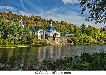 Russian Orthodox Church on the shore of a pond