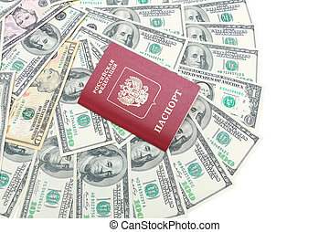 Russian passport closeup on a background of U.S. dollars on a white background. top view - horizontal photo.
