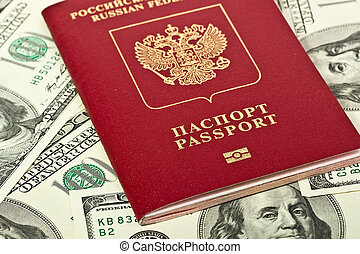 Russian passport on a background of dollars