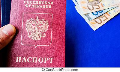 Russian passport on the batch of bills