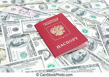 Russian passport on U.S. dollars background